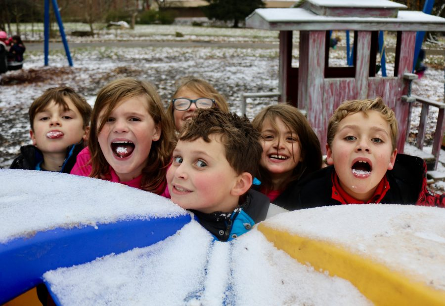 3rd graders enjoying a nibble of snow in aftercare